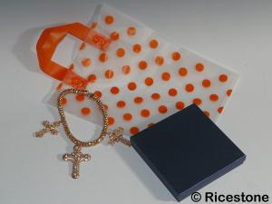 4) Sachet plastique fantaisie à pois orange.